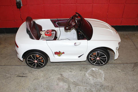 White Bentley Child-Size Sports Car With Red Raven Decals
