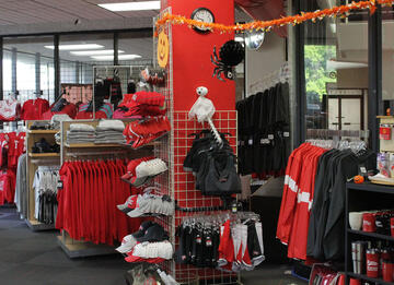 Inside View of the CCC Bookstore Showing a Wide Variety of Red Raven Merchandise