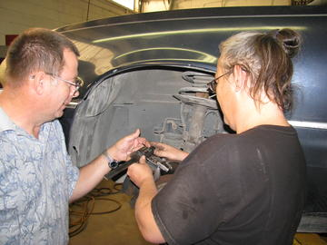 Automotive Student With Instructor Working on Car