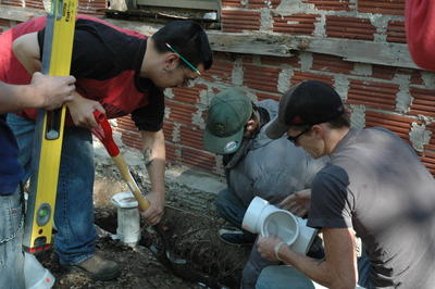 Students Working on Plumbing Project at Brown Mansion