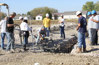 Students Working on Concrete Footings at Athletic Complex Facility