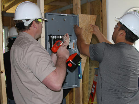 Electrical Students Installing Breaker Box at Habitat for Humanity House in Coffeyville