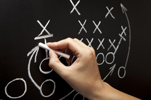 Football X's and O's on Chalkboard Stock Photo