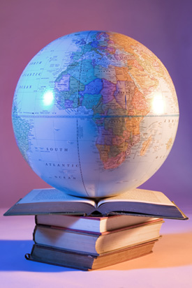Globe Setting on Stack of Books Stock Image