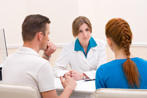 Stock Photo of Counselor Talking With Young Man and Woman