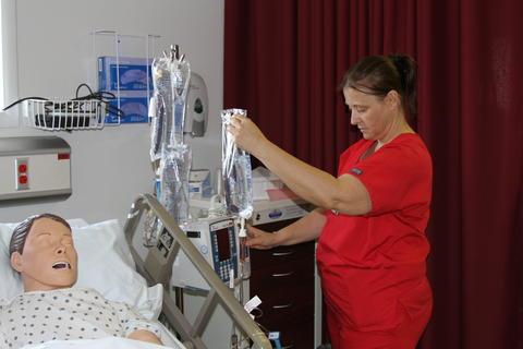 Nursing Student Setting Up IV