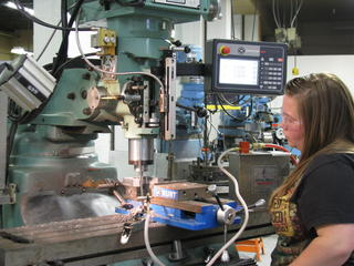 Female Student in Machine Shop