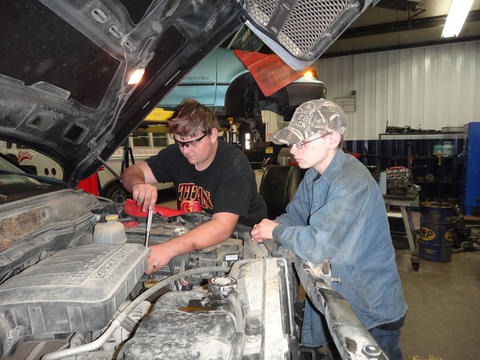 Columbus Auto Students Working On a Pickup Truck