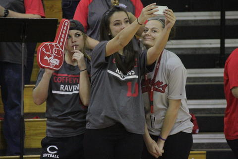 Students at Basketball Game Posing for Selfie