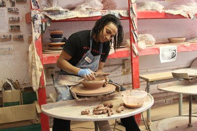 Student Using Potters Wheel