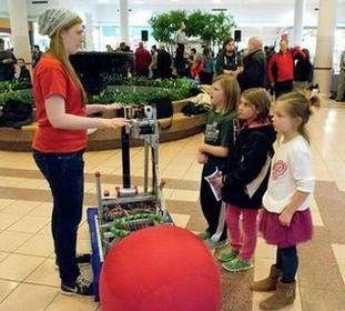 A Linganore High robotics student explains how her club's contraption works.