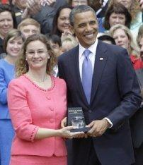 Michelle Shearer receiving the award from President Barack Obama