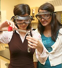 Two students filling a test tube