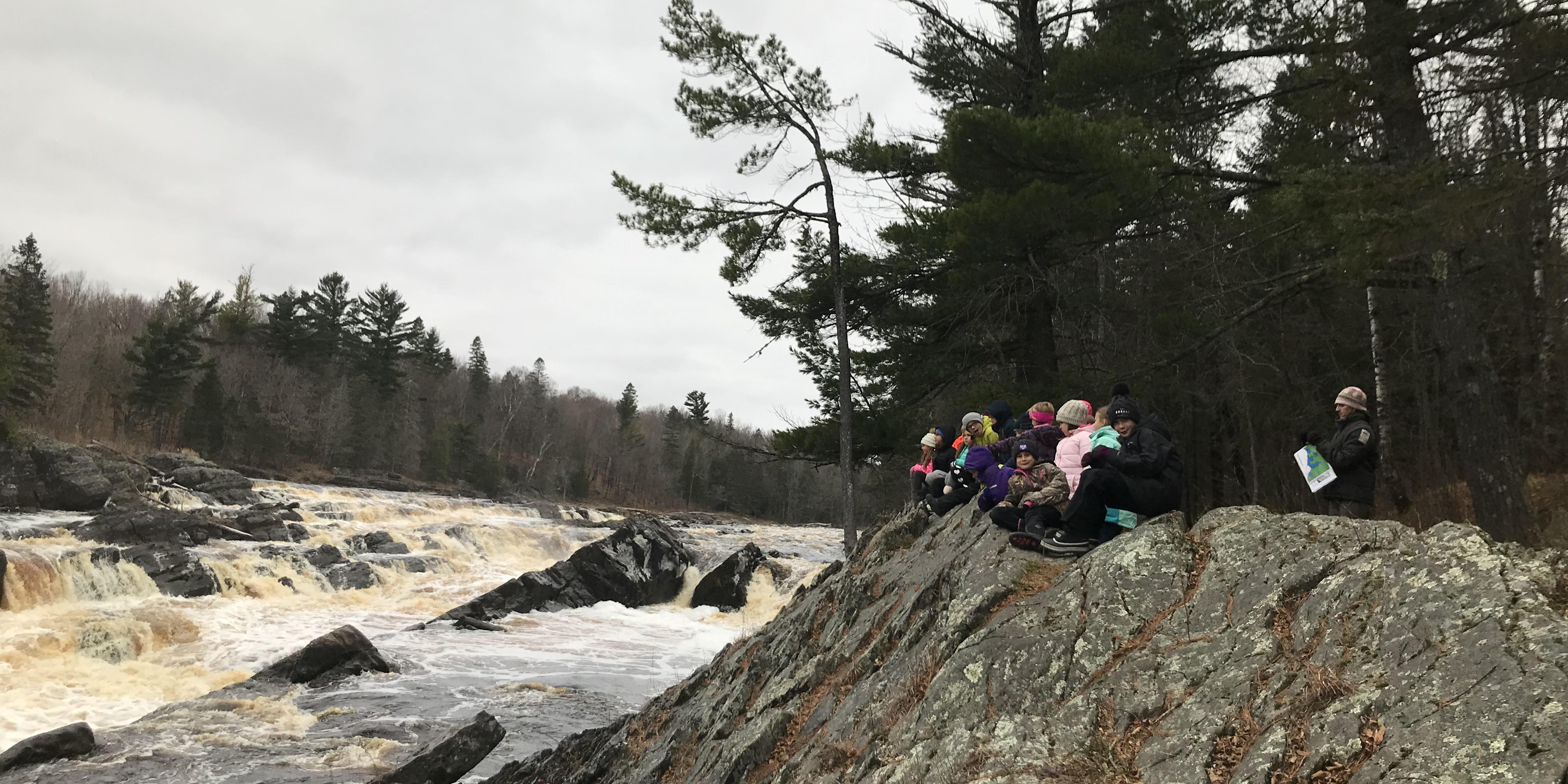 Fourth graders learning about geology at Jay Cooke State Park