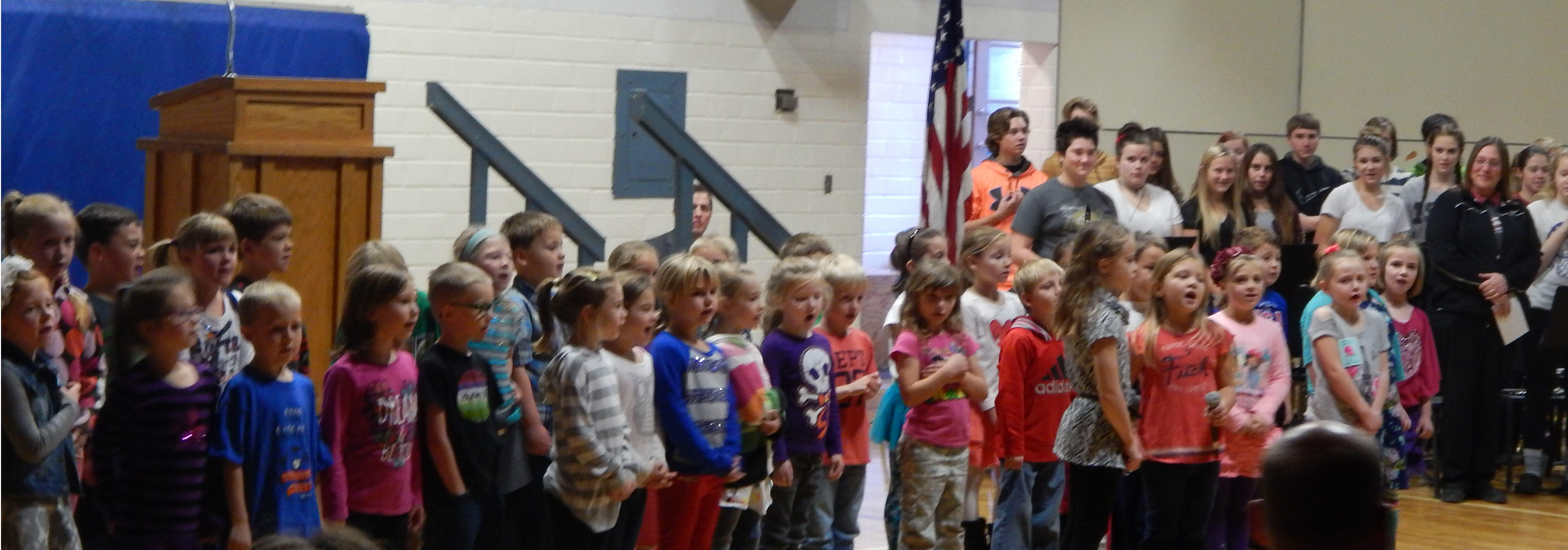 """Carlton First Grader's Led Guests of the Carlton School's Veterans' Day Program in the Pledge of Allegiance and sang """"My Country Tis of Thee"""""""