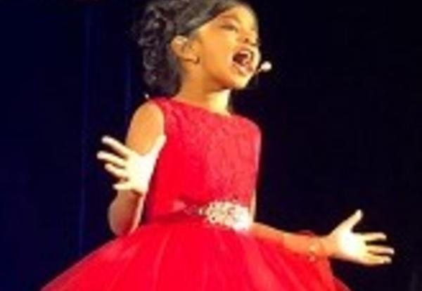Gagani in red dress singing