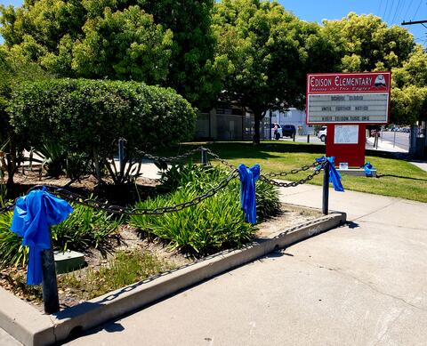 Picture of the front of Edison Elementary decorated with Blue Ribbons