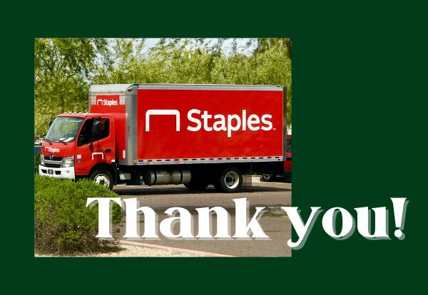 A bright red Staples delivery truck with the words Thank you!