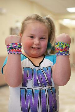 Photo of a happy girl with bracelets
