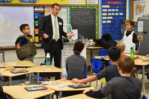 Longfellow Career Day: Pete Angelini talks to students about his day-to-day responsibilities as an FBI agent.