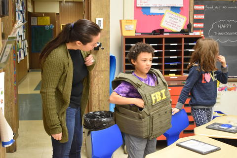 Longfellow Career Day: Students try on a real FBI vest during a Career Day presentation on Nov. 21.
