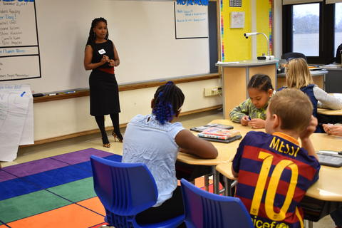 Longfellow Career Day: Students hear a presentation from Camile Lindsay Kumi, the chief legal counsel for the Illinois Department of Corrections.