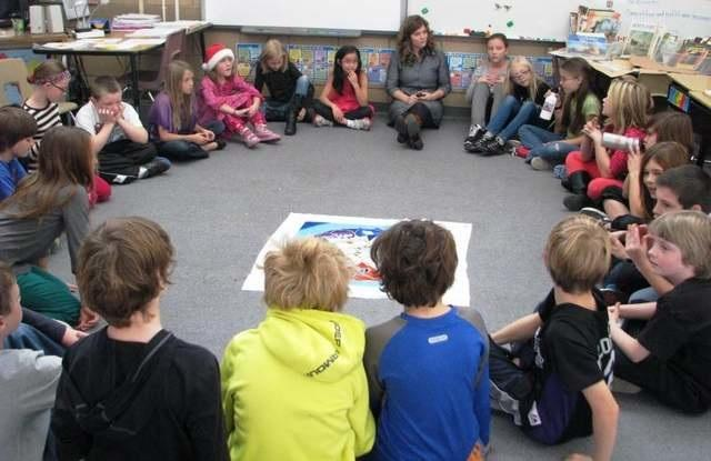 Students in a circle participating in an activity