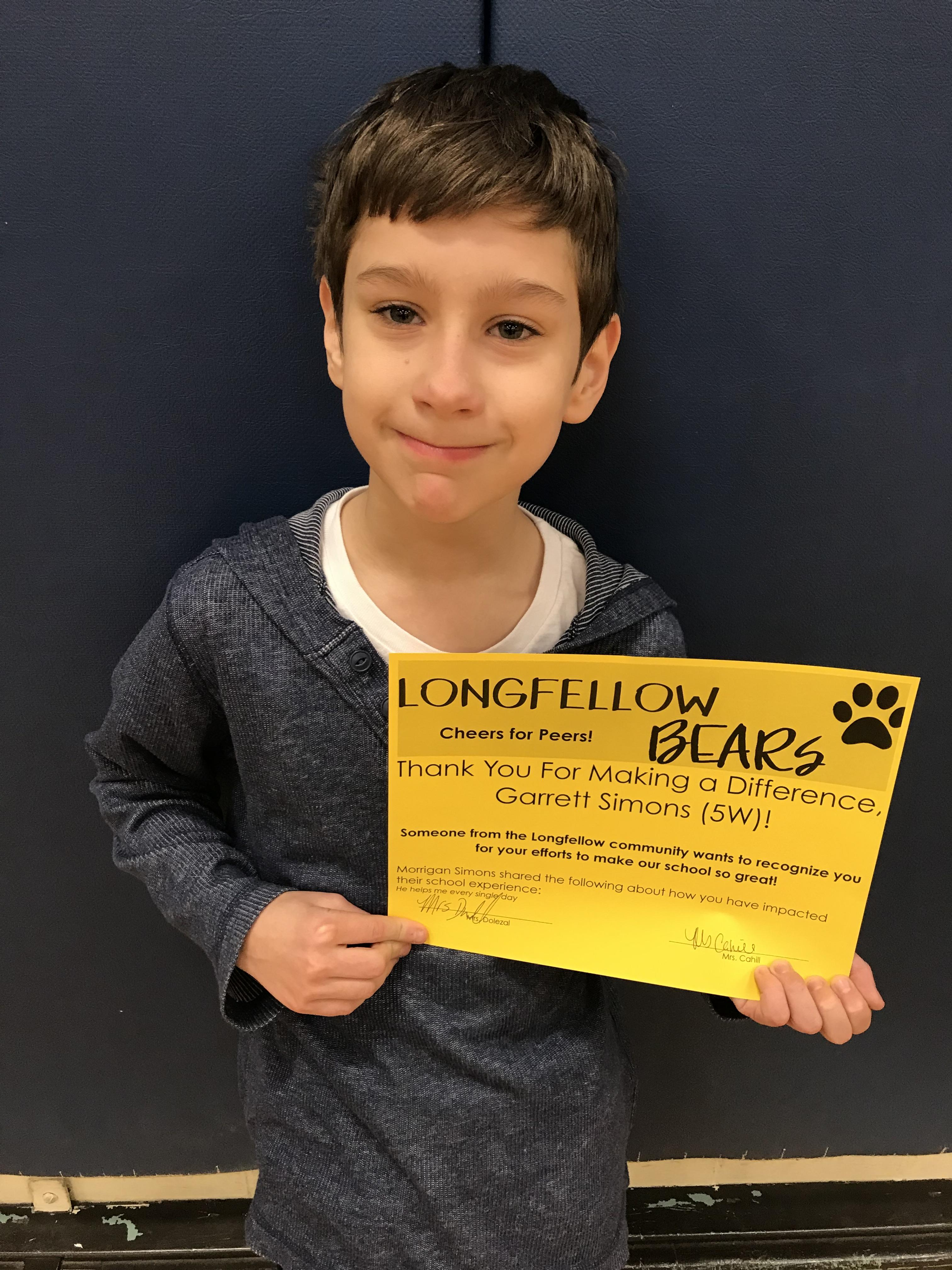 """Student with """"Cheers for Peers"""" certificate"""
