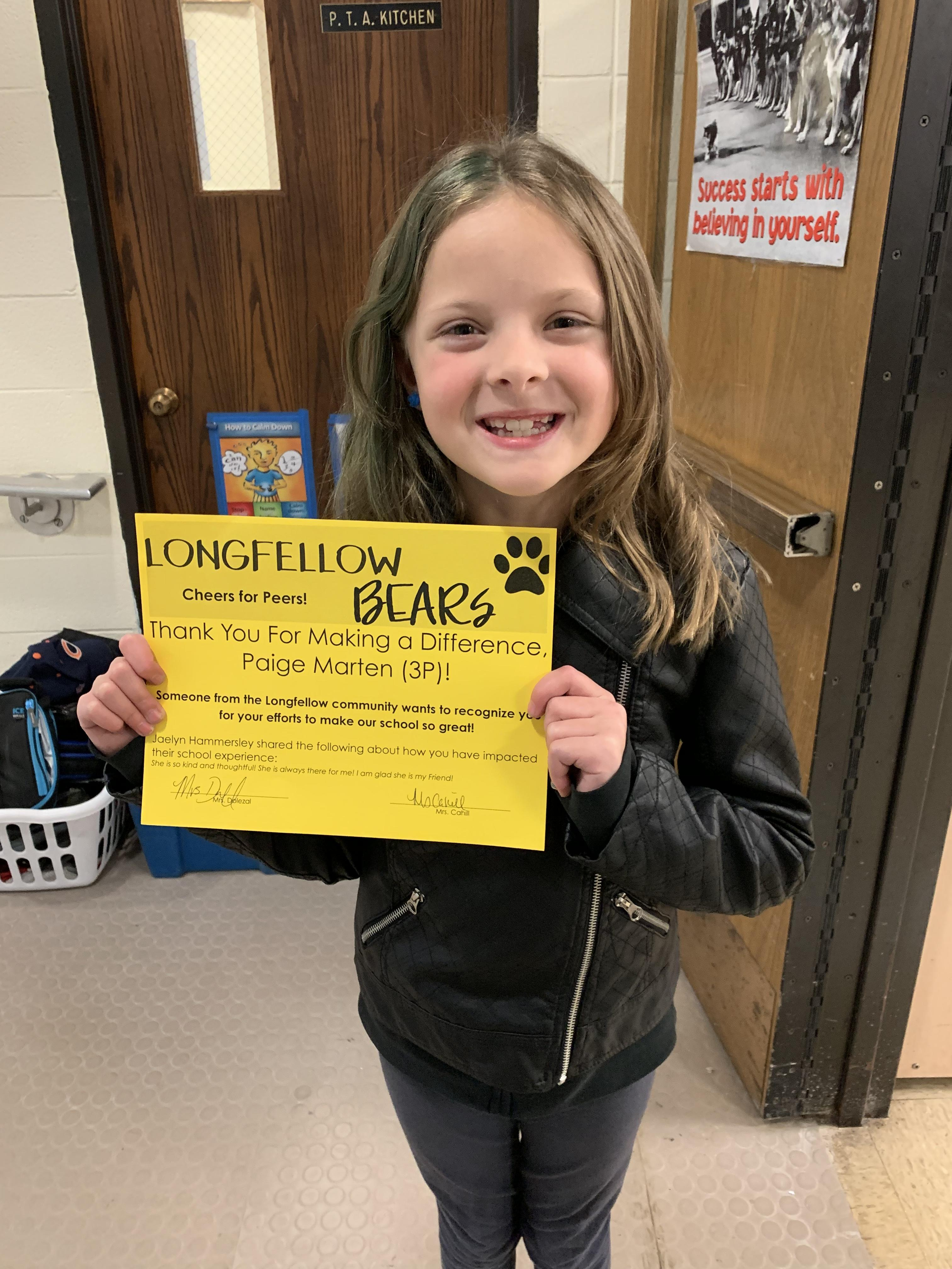 "Student with ""Cheers for Peers"" certificate"