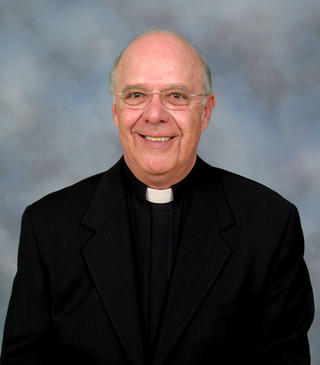 Headshot photo of Fr. Frank Horvat