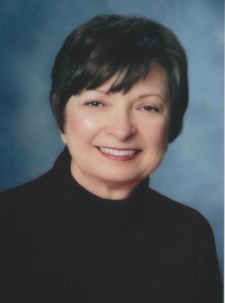 Headshot photo of Marcia Braun