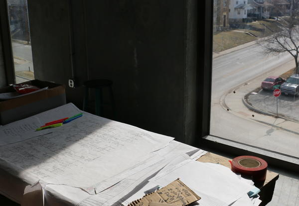 Plans by the window