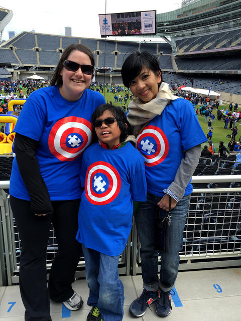 Family with blue superhero t-shirts
