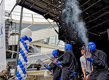 Blue Man Group shooting confetti cannon