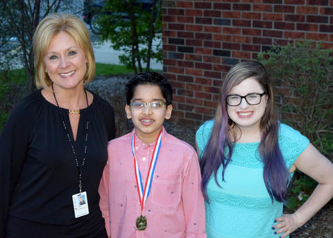 Teacher and female student poses with National Geographic Bee qualifier