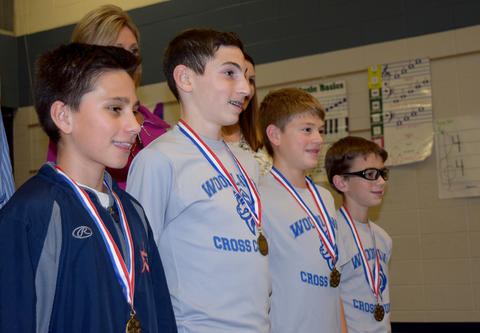 Side view of medal recipients wearing gray t-shirts
