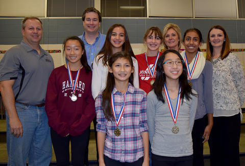 Group of female medal recipients with teachers