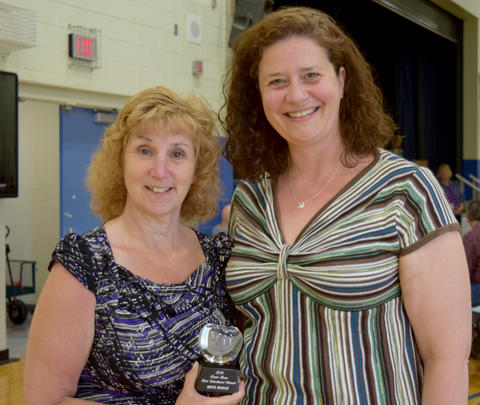 Educational award recipient Beth Busch poses with Lenna Scott