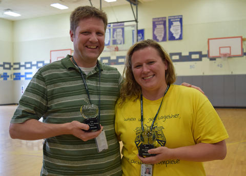 Mr. Hellyer and Ms. Sauer pose with their awards