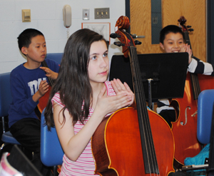 Students learning to play cello