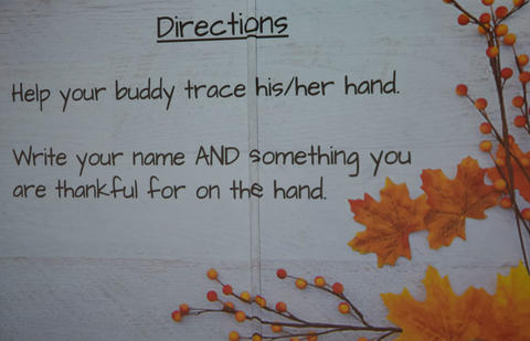 Directions call for tracing hand, then writing name and something one is thankful for