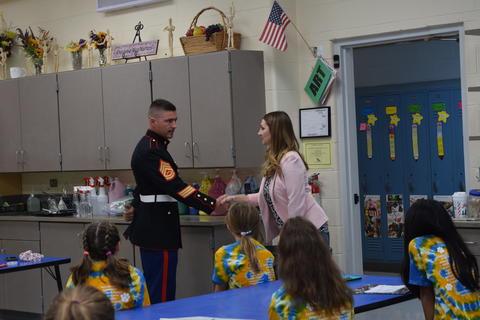 Marine shaking hands with teacher