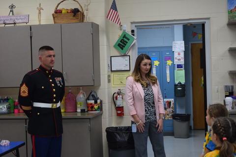 Teacher introduces Marine to class