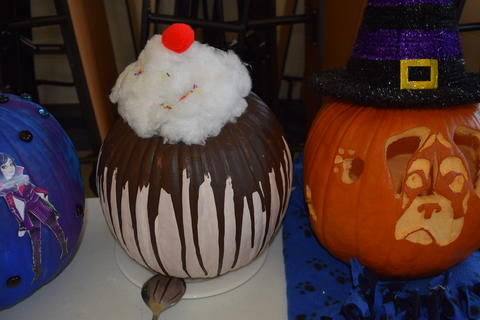 Pumpkin decorated to look like an ice cream sundae