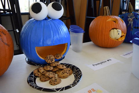 Cookie Monster carved pumpkin has cookies coming out of its mouth