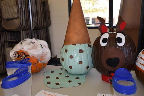 Pumpkin decorated like upside-down mint chocolate ice cream cone