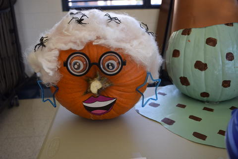 Pumpkin decorated to look like old lady
