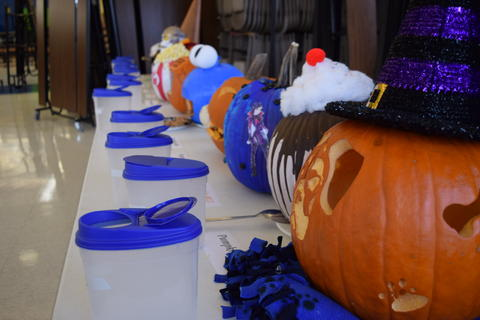 Row of decorated pumpkins