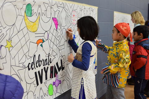 Young boy and girl coloring wall mural