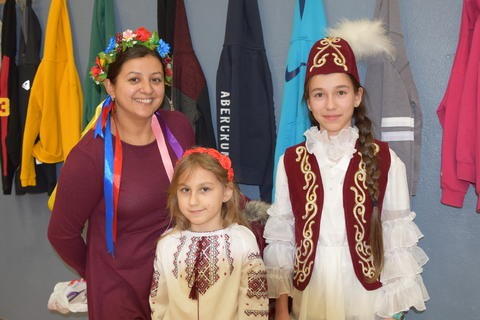 mother and two young daughters in cultural dress